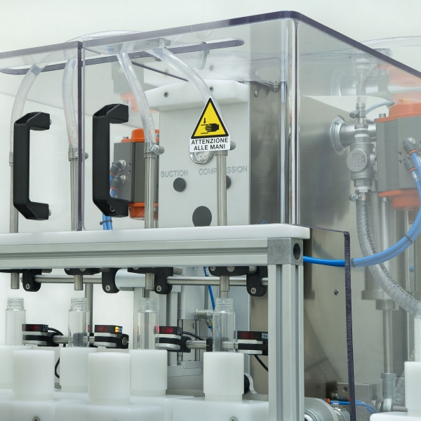 Automatic filling and screw tightening line FC19